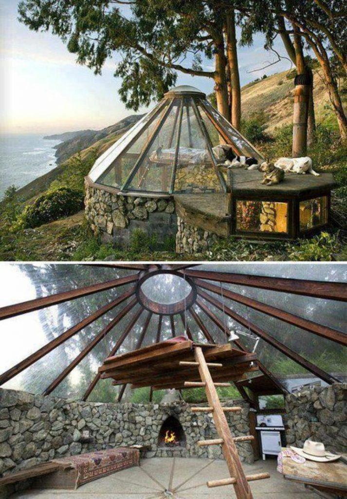 casa pequena yurta cupula cristal mar interior chimenea