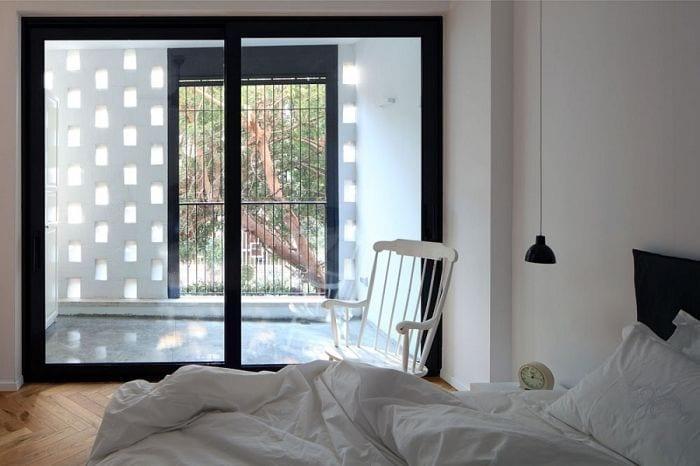 habitacion apartamento remodelado cama balancin salida exterior luz natural