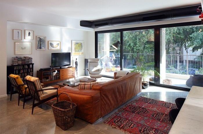 sala estar apartamento remodelado sofa ventanal alfombra
