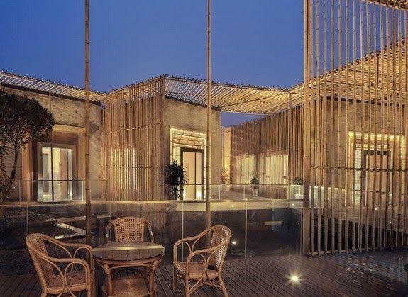 casas bambu exterior estructura vertical sillas suelo