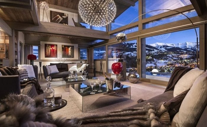 Bright-pops-of-red-and-view-of-snow-covered-Alps-enliven-the-living-space