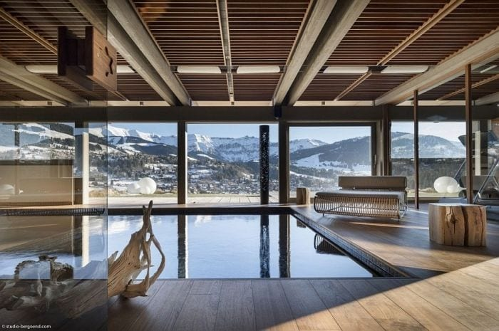 Expansive-indoor-pool-with-jet-streams-and-a-view-of-the-snow-covered-Alps