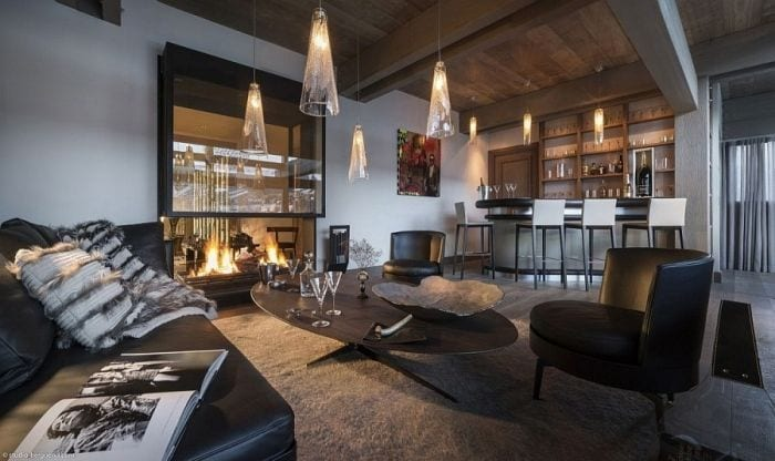 Home-bar-and-fireplace-in-the-lavish-French-Chalet
