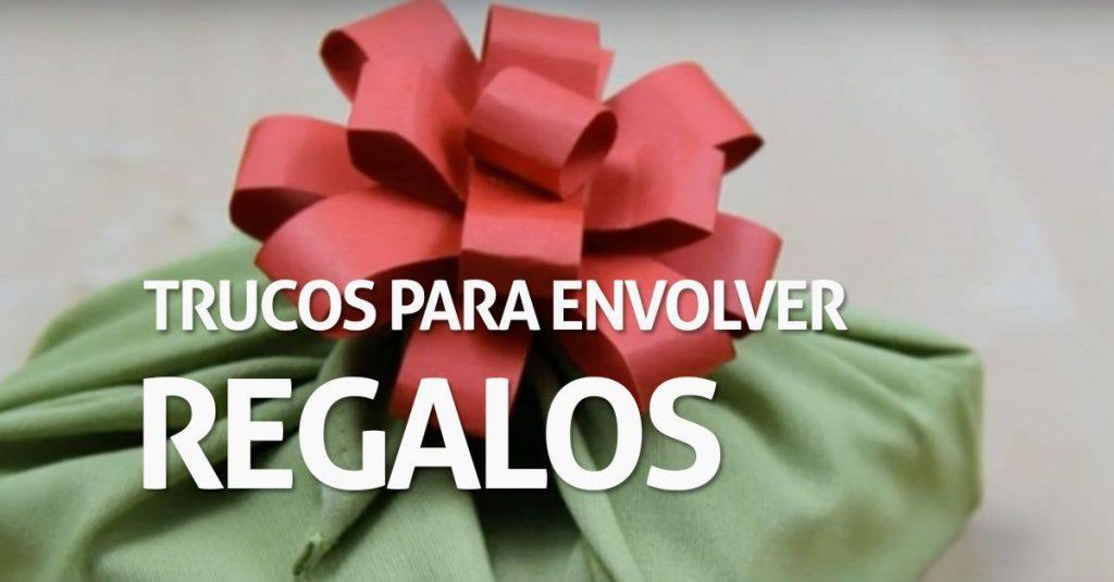 envolver regalos regalo envuelto tela verde lazo rojo destacada
